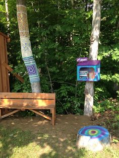 A little library, yarn bombing and a colourful stump
