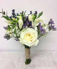 White Rose and Freesia Bride Hand Tied Bouquet. Perfect for rustic or country garden wedding - Bridal Florist, Booker Flowers and Gifts, Booker Weddings, Liverpool Merseyside Purple Wedding Bouquets, Bride Bouquets, Wedding Flowers, Bridesmaid Bouquets, Hand Tied Bouquet, Diy Bouquet, White Rose Bouquet, White Roses, Purple Flower Arrangements