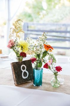 Rustic wedding centerpieces with mismatched bottles / http://www.deerpearlflowers.com/rustic-vintage-wedding-centerpieces-ideas/