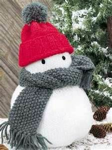 Mr. Flurry snowman -- I love, love, love this knitting pattern. It comes out sooo cute! And, you can use any color yarns to make the hat and scarf that you want.