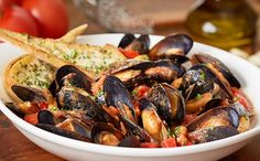 Mussels Tossed In A Homemade Garlic Marinara Sauce Served With Parmesan Breadstick Toast Olive G