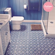 Cornflower blue vinyl flooring in a bathroom