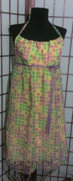 Beautiful Floral Chiffon Summer dress with yellow underlay. Halter knuckling, elastic back with zipper opening. Size 12 available