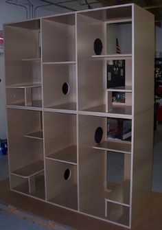 Take bookcase & cut holes in between interior sides and you have a cat condo.  This could also double as a room divider.