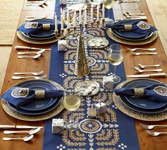 Punched Metal Menorah, Chargers and Napkins Rings. Beautiful detail.  Pottery Barn