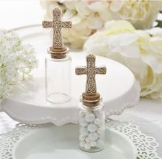 Recuerditos de dulceros para bautizo con cruz.