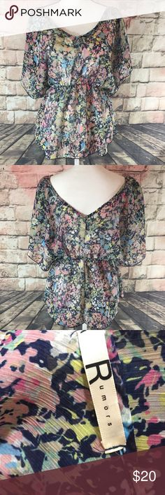 """Rumors colorful Floral top size medium This women's rumors top is a size medium. It measures armpit to armpit 18"""" and the length is 28"""" . It is in good condition Rumors Tops"""