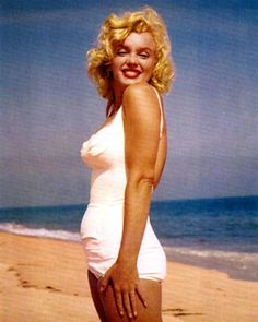 marilyn monroe in white bathing suit | Marilyn Monroe Models Swimsuits and Adds Sizzle to Summer | GlamAmor