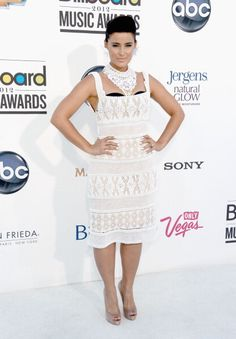 Nelly Furtardo in Alberta Ferretti at the 2012 Billboard Music Awards. Ferretti has been popping up a lot on the red carpet recently–the designer's feminine frocks were all over the red carpet at Cannes–and we hope celebrities' new obsession with the label continues. We love the way Furtado put her own spin on this see-through dress by sporting a black bra and chunky necklace.