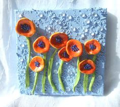 What you see are handmade by this artist, polymer clay poppies that are on a 6x6 inch stretch canvas block. There are 8 poppies that have been painted