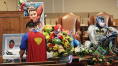 """Dale Hall, dressed as Superman, stands near the casket of his brother Jacob during his funeral in Townville, South Carolina, on Wednesday, October 5. Jacob, 6, was fatally wounded during a shooting last week at an elementary school playground. He loved superheroes, so <a href=""""http://www.cnn.com/2016/10/05/us/jacob-hall-superhero-funeral-townville-south-carolina-school-shooting/"""" target=""""_blank"""">his funeral</a> carried that theme. Funeral attendees were encour..."""
