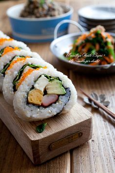 Thick California Roll: Egg Omelete, Crab Stick, Cream Cheese, Avocado, Basil or Lettuce topped with Tobikoko (fish eggs).