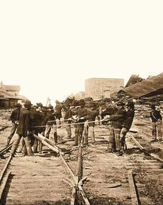 """Atlanta, Georgia… Sherman's Men Tearing Up Railroad Track. Photographed in 1864 by Barnard, George N. Sherman's 62,000 men marched out of Atlanta """"into the fat fields of Georgia like locusts devouring the land"""", Sherman tore up every mile of railroad track and almost every station. #TheAmericanCivilWar"""