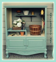 old entertainment center turned into a potting shed