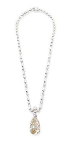 A DIAMOND NECKLACE, BY CARTIER AND A COLOURED DIAMOND PENDANT   Designed as brilliant and baguette-cut diamond collets to the later added pear-shaped yellowish brown diamond pendant weighing 18.60 carats, 38.3 cm long, with French assay marks for platinum and gold  Signed Cartier, no. 9043