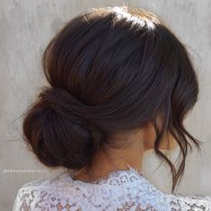 Best hairstyle for weddings all year round.  Modern, chic, textured low updo for dark hair to show dimension.   We are a full service bridal makeup and hair artistry team serving the greater Los Angeles and Orange County.  For makeup and hair bookings, please email beautybybonbon@gmail.com  #texturedupdo #messyupdo #darkhairupdo #hairstylefordarkhair #bridehair #hairinspo #hairideas #hairtrend #chignon #bun