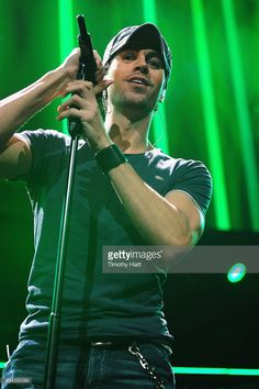 Enrique Iglesias performs onstage during 103.5 KISS FM's Jingle Ball 2013, presented by Jam Audio Collection, at United Center on December 9, 2013 in Chicago, IL.