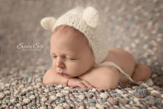 One light studio newborn photography pose.