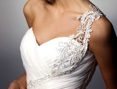 Love the lace applique that has been added a strap to this gown.  Turning common into unique.  Nice touch.
