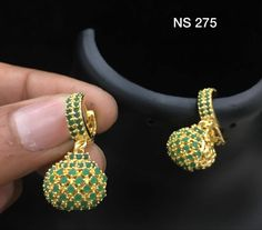 Beautiful ear studs studded with green color czs. 22 September 2017