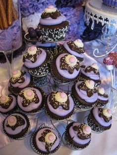 Purple cupcake tower - the cupcakes look like chocolate sundaes #wedding #cupcakes #weddingcupcakes #cupcaketower #purple