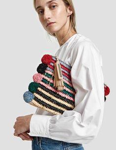 Woven pouch from Loeffler Randall in Rainbow Raffia. Top zip closure with tassel accent. Pom pom trim. Goldtone hardware. Unlined. • Raffia • Wipe clean
