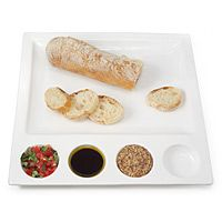 TASTING PLATE Keep dips from pooling into a saucy mess with this multi-pod serving plate. Fill its serving square with rounds of baguette, toasted pita or savory chips to complement up to four different dips or tapenades.