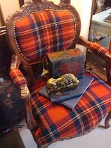 Carved chair with plaid