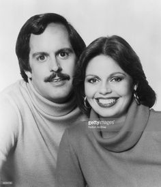 Promotional headshot portrait of married American pop singers the Captain and Tennille (Daryl Dragon & Toni Tennille) wearing turtleneck sweaters. Their biggest hit was 'Love Will Keep Us Together' in 1975.