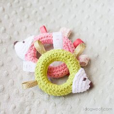 Combine colorful ribbon and crochet to make an adorable hedgehog taggie baby toy. Use as a teether or just a softie friend.