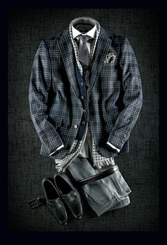 Hugo Boss   Built-in Vest Sport Jacket: $750 Worsted Wool Pants: $298 Wool Tie: $128 Polka Dot Shirt: $198