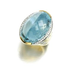 AQUAMARINE AND DIAMOND RING Set to the centre with an oval mixed-cut aquamarine, the wide band set with baguette and square diamonds