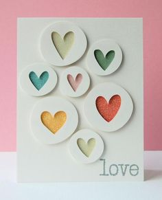 handmade card ... luv ... great graphic look ... white with white circles popped up .... negative space hearts punched from circles and backed in bright colors ... fab look!