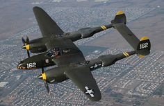 Lockheed P-38 Lightning flying over Chino, California. ~ BFD