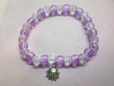 """Stretchy Bracelet Purple back of charm states """"made with a smile"""""""