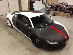 Partial wrap, matte black, with underlays of carbon fiber vinyl to give…