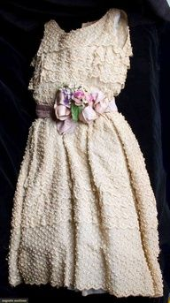CHRISTIAN DIOR COUTURE DRESS, SPRING 1955; Cream organdy embroidered all over in tiny raised sprigs, fitted, sleeveless bodice  fully gathered skirt, mauve silk belt over aqua leather, CF bow  cloth flower bouquet, labeled  stamped 15141, B 32, W 24, L 40, (tears in organdy and bodicefragile, stained) fair. Brooklyn Museum, via Augusta Auctions