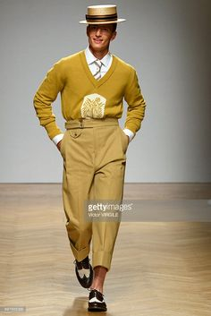 A model walks the runway at the Daks show during Milan Men's Fashion Week Spring/Summer 2018 on June 18, 2017 in Milan, Italy.