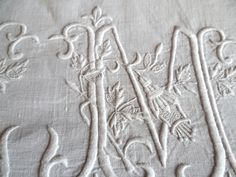 Magnificent M interlaced with fuchsias on a pure linen sheet. Sold by chatelaine-chic