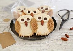 Send your guests home with something sweet and creative, like these tasty butter owl cookies by Heather Baird. Acorn Cookies, Owl Cookies, Cookies Et Biscuits, Sugar Cookies, Yummy Treats, Sweet Treats, Yummy Food, Cookie Recipes, Dessert Recipes