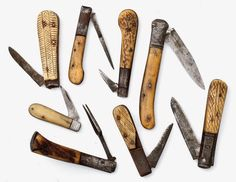 Seven primitive folding knives from Cowan's Auction