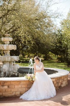 Bridal portraits at Clark Gardens in Weatherford, TX. Photo Credit: Swan Photography / Planner: Wisteria Lane Weddings / Floral: From A to Z Design / Venue: Clark Gardens / Dress: Bow and Arrow Bridal Clark Gardens, Weatherford Tx, Garden Dress, Wisteria, Bridal Portraits, Photo Credit, Floral Wedding, Swan, Arrow