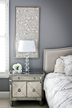Framed wallpaper above night stands? Coordinate by wallpapering closet?love the dark gray wall color, light gray textured headboard with beading, the clean look of the down comforter, the glass end table and the framed wallpaper as art work. Interior Design, Bedroom Decor, Furniture, Beautiful Bedrooms, Home, Interior, Bedroom Inspirations, Home Bedroom, Home Decor