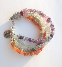 A personal favorite from my Etsy shop https://www.etsy.com/listing/178406092/gemstone-chips-bracelet-layered