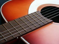 acoustic guitar close-up showing frets