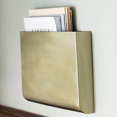 revere gold wall mounted magazine storage | CB2 -- by desk or under bar. would be cool to pair with a few of the scope iron shelves