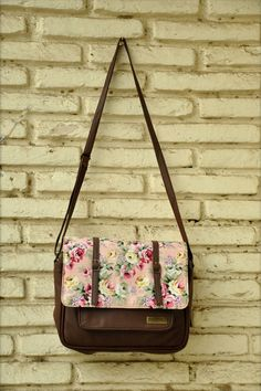 """Floral Bloom Messenger Bag - Exude a floral charm this summer with a beautiful and delicate messenger bag. Flap closure bathed in pink glory with blooming flowers adds a unique statement to this basic number. Extendable shoulder sling.  Colour:  Brown, Multi.  Material:  PU.  Dimensions:  9.5"""" x 2.25"""" x 8.75"""".  Estimated delivery within 14 - 21 days after ordering."""