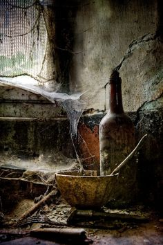 Old bottle and cobwebs, abandoned, spider webs, spindelvæv, decay, invironment, long gone, history, cracks, decay, photo.