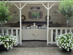 A shady place of loveliness. Porch Veranda, Porch And Balcony, Outdoor Rooms, Outdoor Gardens, Outdoor Living, Indoor Outdoor, Dream Garden, Home And Garden, Wedding Reception Flowers