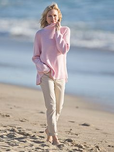 Naomi Watts looks cozy in a pink sweater as she films a milk commercial in Malibu, California, on Thursday.